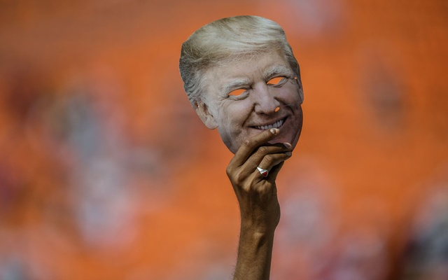 A person displays a mask depicting President Donald Trump, during an event with Trump and Indian Prime Minister Narendra Modi at Motera Stadium in Ahmedabad, India, Monday, Feb 24, 2020. The New York Times