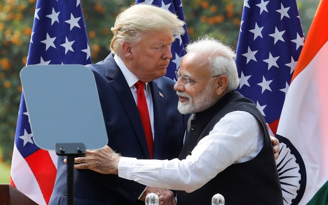 US President Donald Trump and India's Prime Minister Narendra Modi embrace during a joint news conference after bilateral talks at Hyderabad House in New Delhi, India, February 25, 2020. Reuters