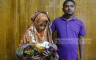 Parents of 32-day-old Abdullah posing for a photograph after the infant underwent a surgery to remove a parasitic twin from his body on Wednesday. Photo: Mahmud Zaman Ovi