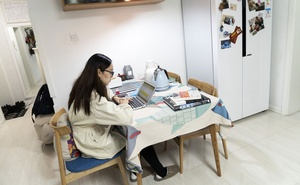 Vigor Liu works on a laptop in her home in Beijing on Feb 11, 2020. The New York Times Caption 04: Clothes, masks and goggles that Vigor Liu prepared for her baby sit in her home in Beijing on Feb 11, 2020. The New York Times