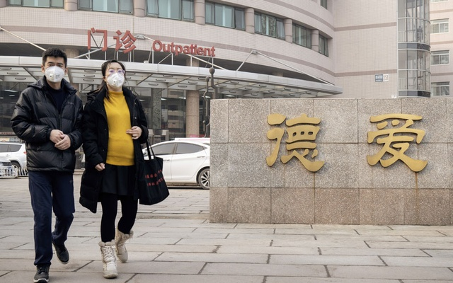 A pregnant woman leaves an obstetrics hospital in Beijing on Feb 11, 2020. The New York Times