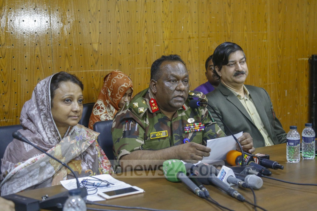 Brig Gen AKM Nasir Uddin, director of Dhaka Medical College Hospital or DMCH, briefs the media after a surgery to remove a parasitic twin from a 32-day-old child, Abdullah, at the hospital on Wednesday. Photo: Mahmud Zaman Ovi