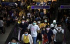 Commuters wearing protective masks walk inside the MRT subway in Bangkok, Thailand Feb 24, 2020. REUTERS