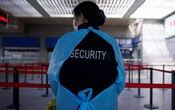 A security guard wearing a face mask is seen at the Shanghai railway station in Shanghai, China, as the country is hit by an outbreak of a new coronavirus, Feb 27, 2020. REUTERS