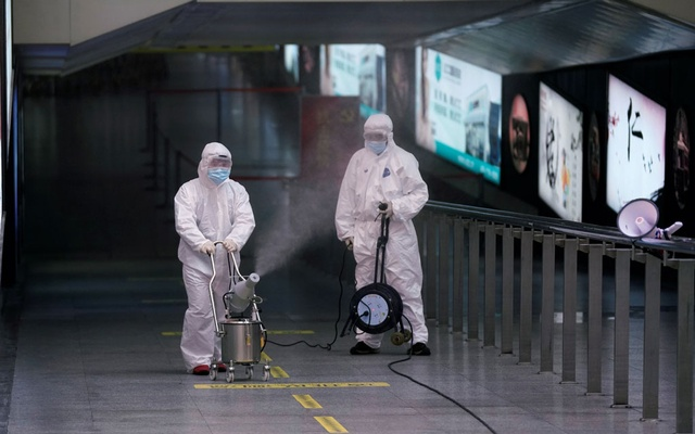 Workers with sanitising equipment disinfect at the Shanghai railway station in Shanghai, China, as the country is hit by an outbreak of a new coronavirus, Feb 27, 2020. REUTERS