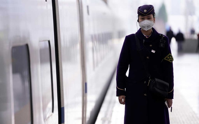 A train staff wearing a mask is seen at the Shanghai railway station in Shanghai, China, as the country is hit by an outbreak of a new coronavirus, Feb 27, 2020. REUTERS