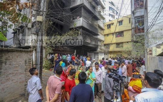Onlookers gather outside a residential building on Dilu Road in Dhaka's Eskaton after a deadly fire incident on Thursday early morning. Photo: Asif Mahmud Ove