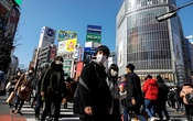 People wearing protective masks are seen in the Shibuya shopping district in Tokyo, Japan, Feb 24, 2020. REUTERS