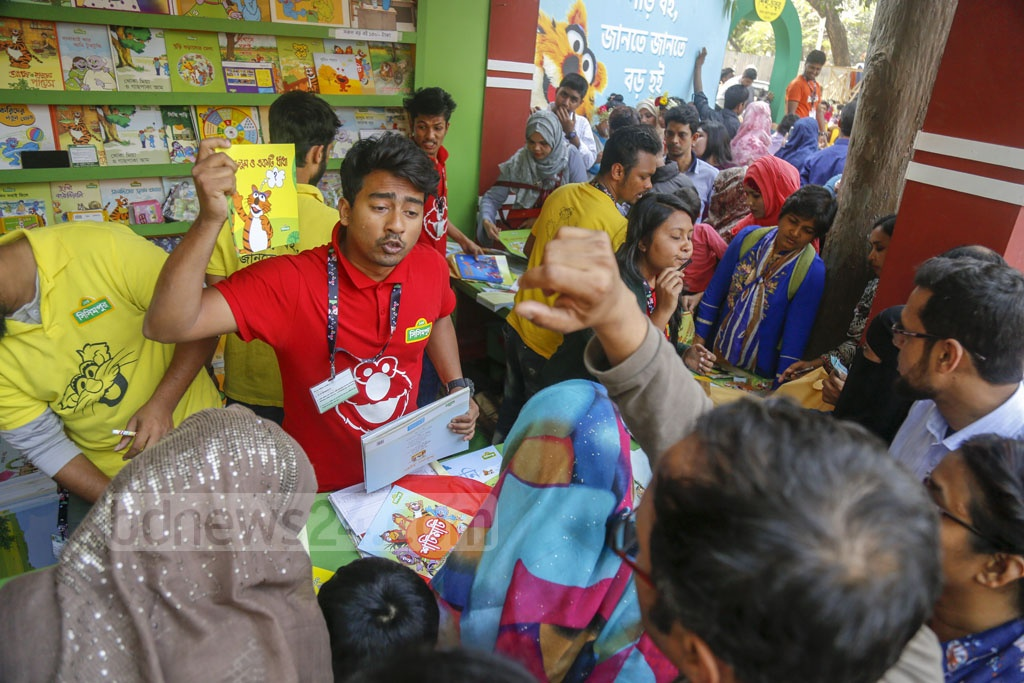 Parents crowding a stall at the Ekushey Book Fair to buy books for their children on Friday. Photo: Mahmud Zaman Ovi