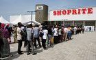 People gather to enter the newly commissioned Shoprite store at Novare Gateway mall Abuja, Nigeria Nov 30, 2017. REUTERS/FILE