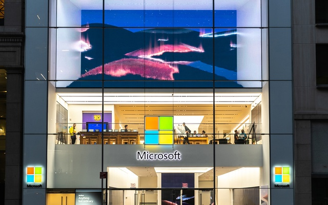 People walk through a Microsoft building in New York on Oct 2, 2019. Microsoft cut its sales forecast for a division that makes laptops and tablets after the coronavirus outbreak hampered production. The New York Times