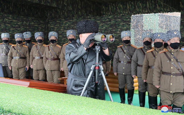 North Korean leader Kim Jong Un uses binoculars while attending a drill by a unit of the Korean People's Army (KPA), North Korea in this image released by North Korea's Korean Central News Agency (KCNA) on Feb 29, 2020. REUTERS