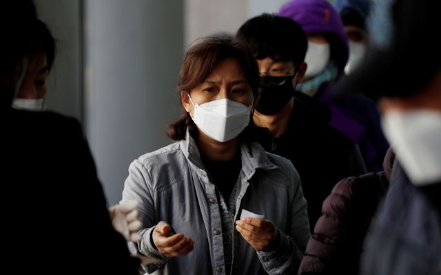 People stand in a queue to buy face masks at a post office, after a shortage of masks amid the rise in confirmed cases of the novel coronavirus disease COVID-19, in Daegu, South Korea, Mar 4, 2020. REUTERS