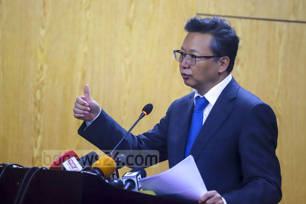 Chinese Ambassador in Dhaka Li Jiming addresses a press briefing to give updates on projects run by the Chinese companies at the offices of Padma Bridge rail link in Keraniganj on Wednesday. Photo: Asif Mahmud Ove