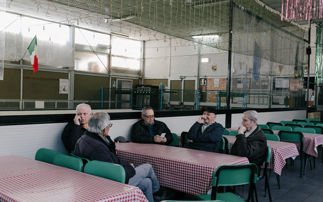 A table of men sit near empty bocce ball courts in a Milan recreation centre on Mar 4, 2020. Italy's elderly suffer the heaviest toll in the spreading coronavirus outbreak and spikes in the numbers of deaths and cases have become the new normal in the country with Europe's oldest population. The New York Times