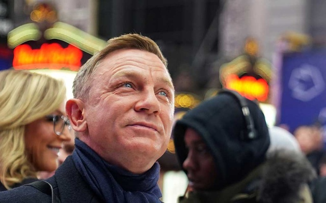 Actor Daniel Craig reacts during a promotional appearance on TV in Times Square for the new James Bond movie