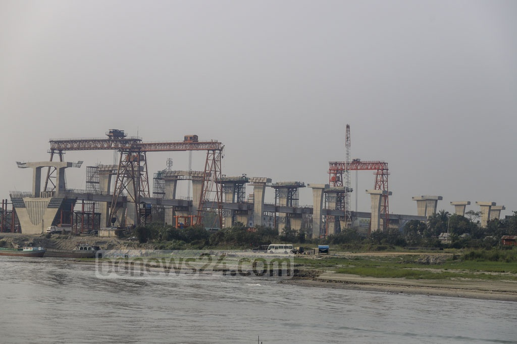 Construction of the Padma Bridge is under way at the Mawa end.