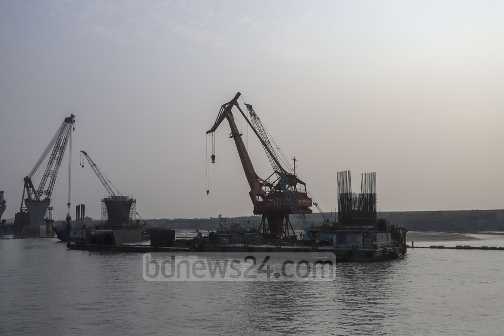 Workers setting up a pier of the Padma Bridge.