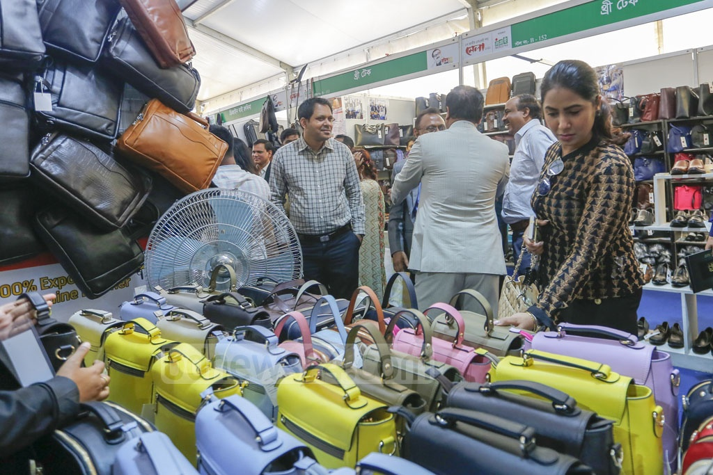 A woman checking clothes at the National SME Product Fair at the Bangabandhu International Conference Centre in Dhaka on Thursday. Photo: Mahmud Zaman Ovi