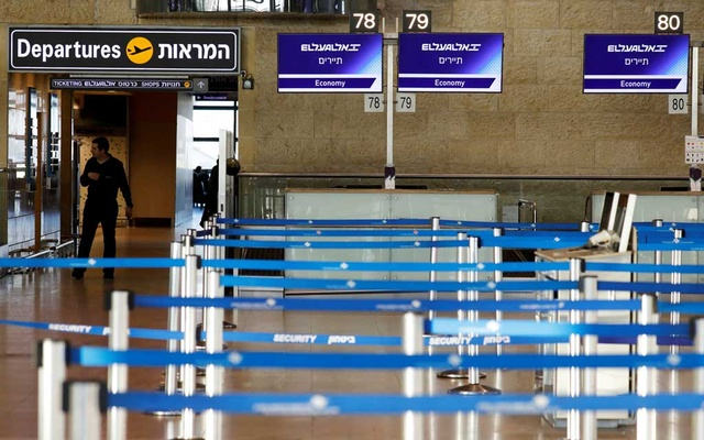 FILE PHOTO: Empty El Al Israel Airlines check-in counters are seen at Ben Gurion International airport in Lod, near Tel Aviv, Israel February 27, 2020. REUTERS