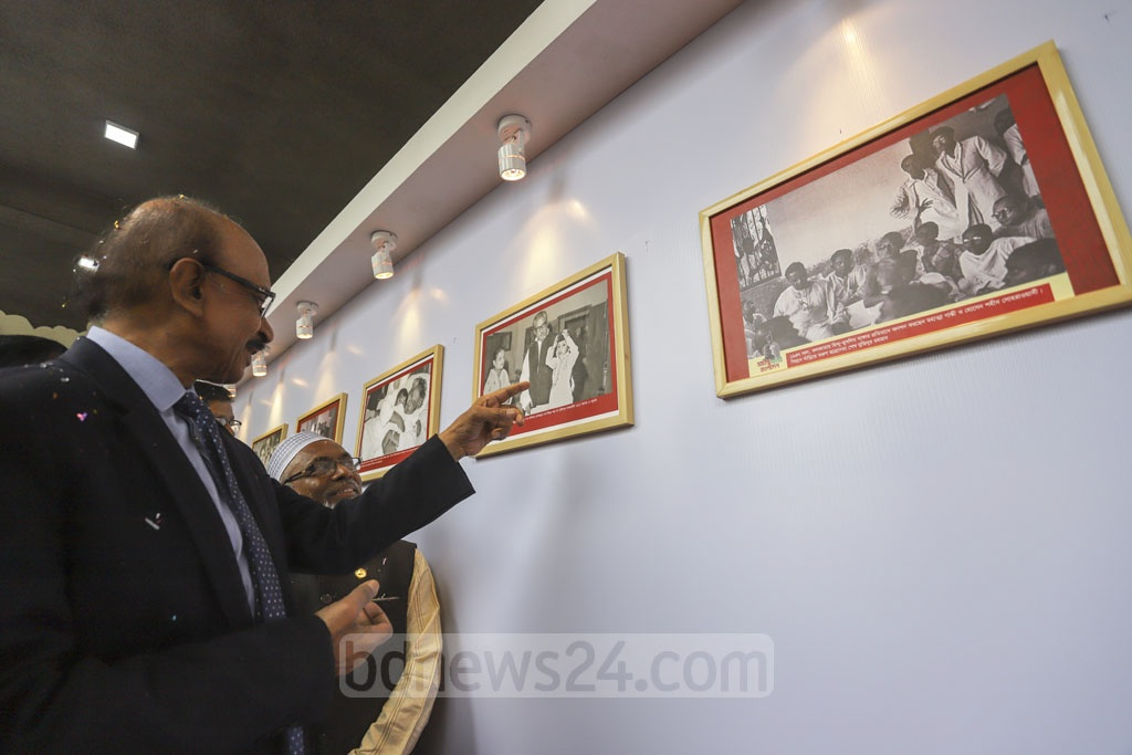 Guests taking a look at the Bangladesh Bank's Bangabandhu Gallery in Dhaka's Motijheel on Sunday with photos of Sheikh Mujibur Rahman celebrating the birth centenary of the Father of the Nation. Photo: Asif Mahmud Ove