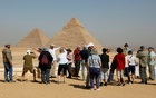 Tourists gather at the Great Pyramids of Giza, on the outskirts of Cairo, Egypt Mar 8, 2020. REUTERS