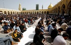Muslim pilgrims sit during Friday prayers, following the coronavirus outbreak, at the Kufa mosque in the holy city of Najaf, Iraq Mar 6, 2020. REUTERS
