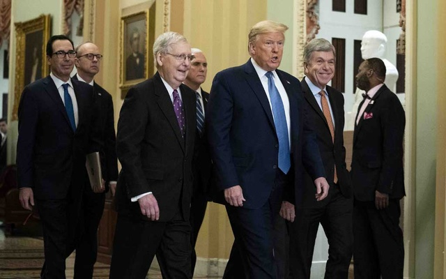President Donald Trump, center, is flanked by Senate Majority Leader Mitch McConnell (R-Ky), left, and Sen Roy Blunt (R-Mo) as he visits the Capitol on Tuesday, March 10, 2020. Trump and lawmakers raced on Tuesday to negotiate an emergency relief package to bolster an economy battered by the coronavirus crisis, with lawmakers and administration officials expressing optimism for a deal despite partisan divisions about what should be included. (Doug Mills/The New York Times)
