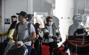 FILE -- Travelers at Kennedy International Airport in New York, Feb 27, 2020. Lawmakers raced on Tuesday to negotiate an emergency relief package to bolster an economy battered by the coronavirus crisis, with lawmakers and administration officials expressing optimism for a deal despite partisan divisions about what should be included. (Stephanie Keith/The New York Times)