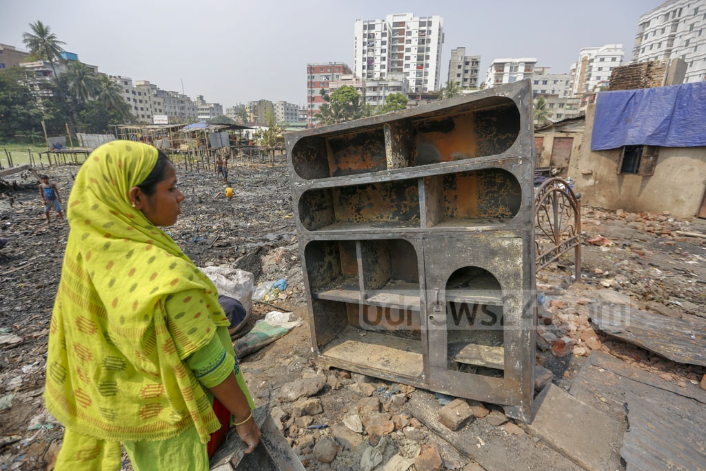 Salma, a pregnant woman, has nothing but a steel showcase after a fire destroyed hundreds of shanties of Jhilpar slum in Dhaka's Mirpur last Wednesday. Photo: Mahmud Zaman Ovi
