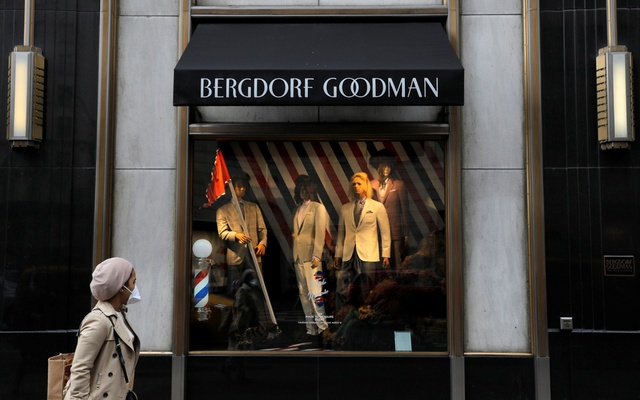 A person wearing a face mask walks by Bergdorf Goodman on Fifth Avenue as retailers reported a downturn in sales related to the coronavirus outbreak in Manhattan, New York City, New York, US, March 13, 2020. Reuters