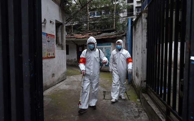 Community workers in protective suits disinfect a residential compound in Wuhan, the epicentre of the novel coronavirus outbreak, Hubei province, China March 6, 2020. REUTERS