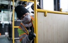 Tyler Goodwin, a utility service worker for King County Metro Transit, disinfects a bus in Seattle, on Tuesday, March 3, 2020. (Grant Hindsley/The New York Times)