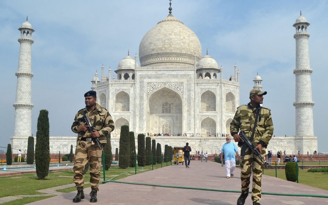Central Industrial Security Force (CISF) personnel patrol at the historic Taj Mahal premises in Agra, India, Feb 20, 2020. REUTERS