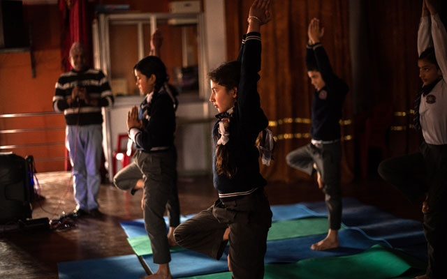 Children take part in a yoga class at Mount Genius English School, in Kathmandu, on Jan 27, 2020. The New York Times