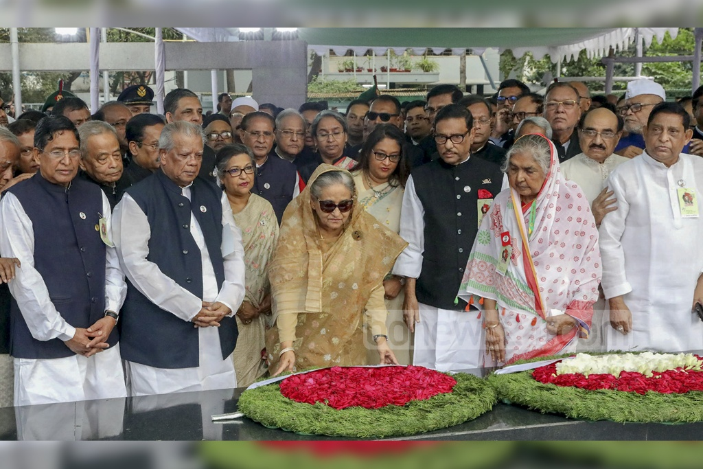 Prime Minister Sheikh Hasina and other leaders of the Awami League paid respects to Bangabandhu Sheikh Mujibur Rahman by placing wreath on his grave at Tungipara in Gopalganj on his birth centenary Tuesday. Photo: Saiful Islam Kallol
