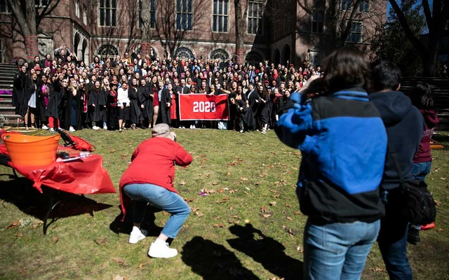 Wellesley College seniors pose for a group photo during an unofficial