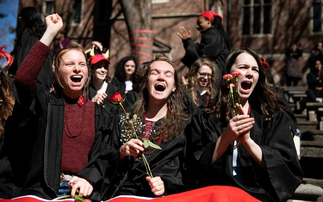 Wellesley College seniors cheer during an unofficial