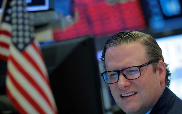 A trader reacts as he works on the floor of the New York Stock Exchange (NYSE) in New York, US, March 18, 2020. REUTERS