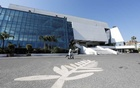 A man skates past a Palme d'Or symbol on the pavement near the Festival palace on the Croisette in Cannes where the Cannes Film Festival and the Cannes Lions take place, as a lockdown is imposed to slow the rate of the coronavirus disease (COVID-19), in France, Mar 18, 2020. REUTERS