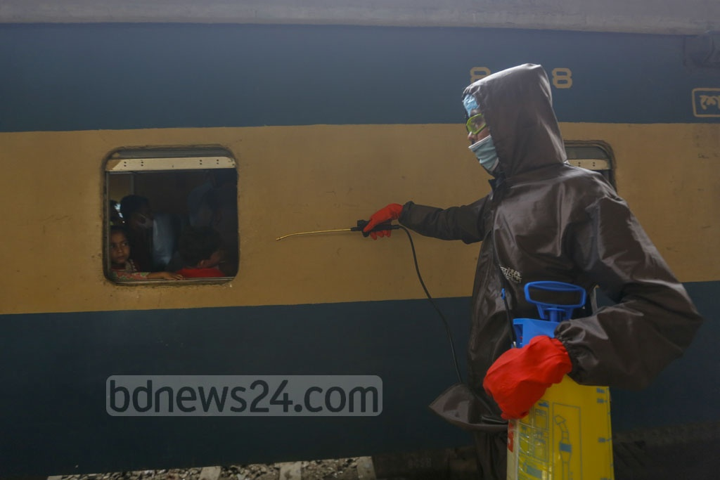 Volunteers of Bidyananda Foundation spray Isopropyl alcohol to disinfect different crowded places in Dhaka. Photo: Mahmud Zaman Ovi