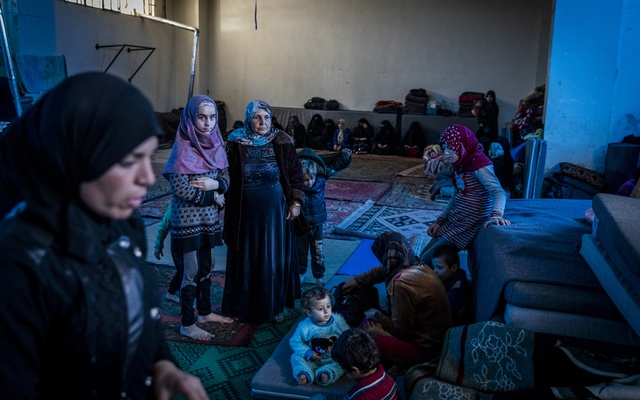 Syrian families displaced by recent fighting at a sports stadium in Idlib City, Syria, March 4, 2020. In devastated northwestern Syria, the coronavirus may already be spreading in packed displacement camps, and the international response is weeks behind. (Ivor Prickett/The New York Times)