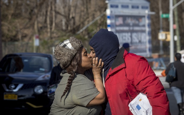 Rayshad Jackson, right, is greeted by his wife, Courtney, after he was released from the Rikers Island jail complex in New York, Friday, Mar 20, 2020. The New York Times