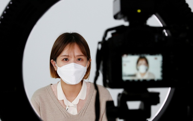 SSUNZY, a beauty content YouTuber, records YouTube video clips on makeup tutorials catered to those wearing masks, following the outbreak of the coronavirus disease (COVID-19), at a studio in Seoul, South Korea, Mar 17, 2020. REUTERS