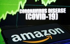 Amazon logo is seen in front of displayed coronavirus disease (COVID-19) in this illustration taken Mar 19, 2020. REUTERS