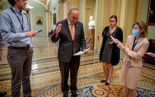 Senate Minority Leader Chuck Schumer (D-NY) speaks to media after a meeting with Treasury Secretary Steve Mnuchin to wrap up work on coronavirus economic aid legislation to prevent the spread of coronavirus disease (COVID-19) in Washington, US, Mar 21, 2020. REUTERS