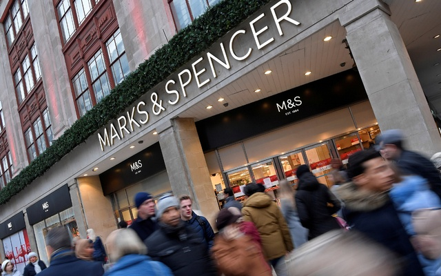 FILE PHOTO: Shoppers walk past at a branch of the British clothing and food retailer Marks and Spencer on Oxford Street in London, Britain, January 3, 2019. Reuters