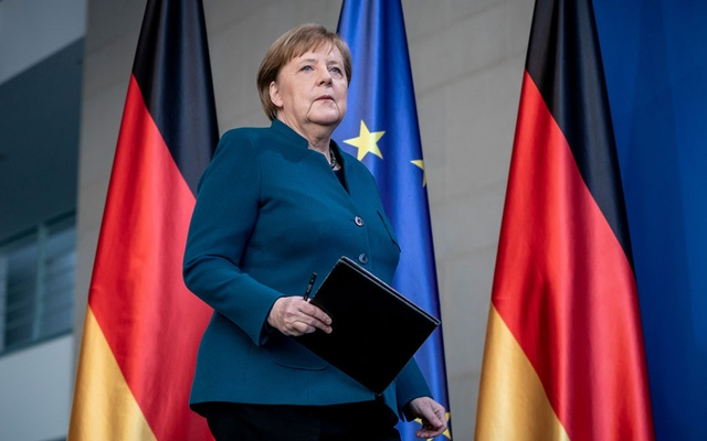 German Chancellor Angela Merkel arrives for a media statement on the spread of coronavirus at the Chancellery in Berlin, Germany, March 22, 2020. Reuters