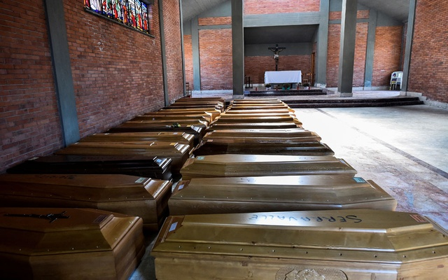 Coffins of people who have died from coronavirus disease (COVID-19) are seen in the church of the Serravalle Scrivia cemetery, which like many places in northern Italy is struggling to cope with the number of deaths from the virus that is growing every day, in Alessandria, Italy, March 23, 2020. Reuters