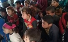 In a photo provided by Qassem al-Ahmad, many of the children attending a makeshift school outside Bhora, in northwestern Syria, have not attended a class in years. The New York Times